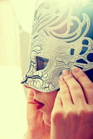 Sexy woman in masquerade mask in vintage style photo