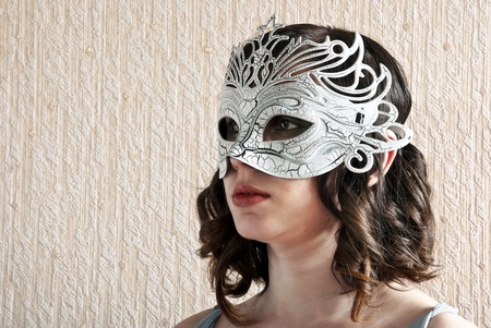 Beautiful young woman in black and white venetian mask. photo