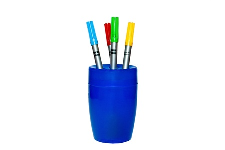 Color pencil in the blue glass on the white background  photo