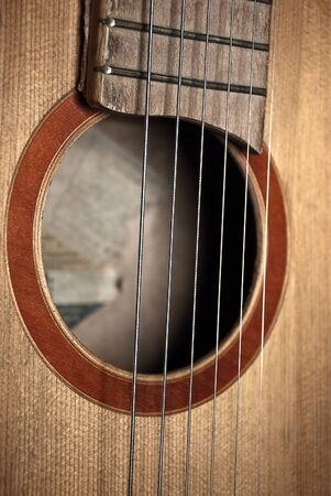 solo form: Detail of classic guitar with shallow depth of field