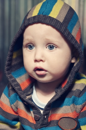 Closeup portrait of adorable child in hood. photo