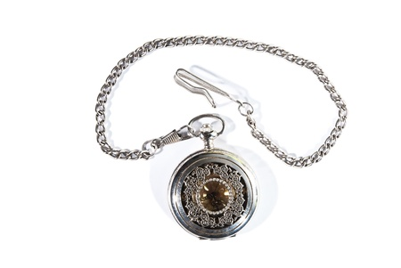 Closed vintage pocket watch on the white background  photo
