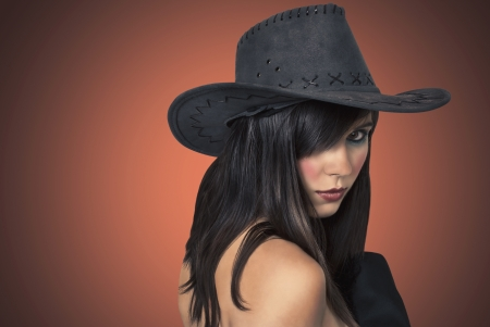 sexy young woman in a hat cowboy  photo