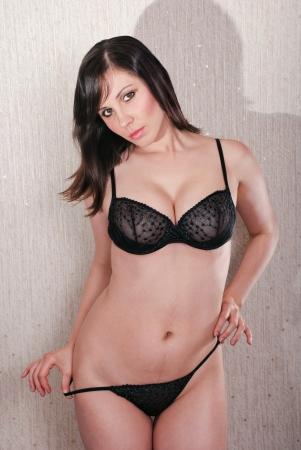 Beautiful young woman in sexy black lingerie. Studio shot Stock Photo - 16661830