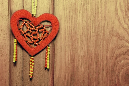 Red heart on the old wood background