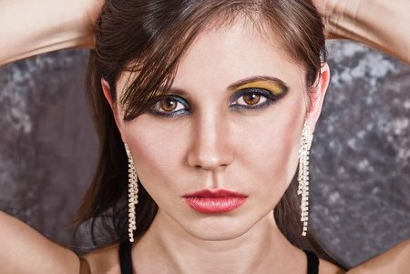 Closeup portrait of an attractive woman. Fashion studio shot Stock Photo