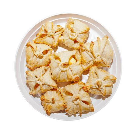 Delicious crunchy sweet puffs in a bowl on the isolated background  Stock Photo