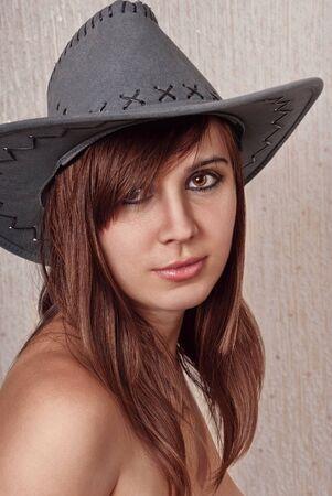 Portrait beautiful brunette in cowboy hat