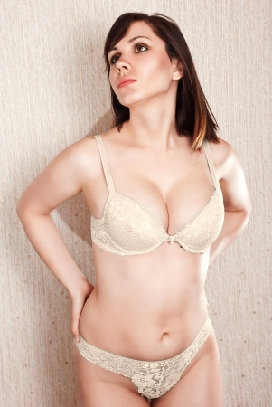 Portrait of a beautiful girl in sexy flesh colored underwear.