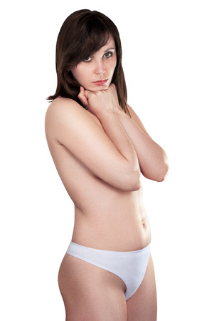 naked body: Sexy brunette in white panties covering his hands chest. isolated image