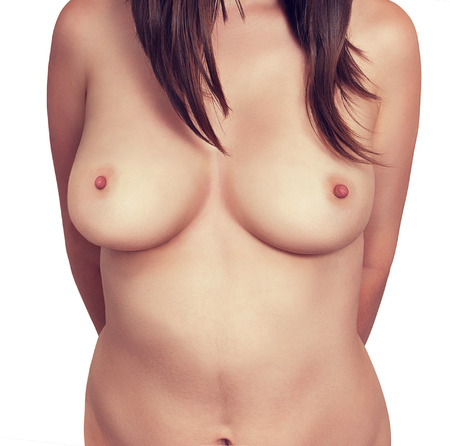 breast beauty: Naked female breast close-up on a white background.