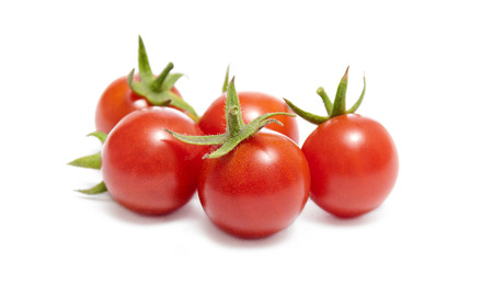 Ripe red cherry tomatoes on white background  写真素材