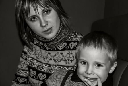 Black and white portrait of mother and son photo