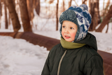 Portrait handsome little boy outdoors in winter