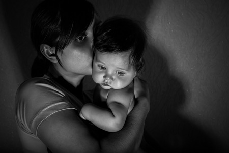 Black and white portrait of happy mother with baby. photo