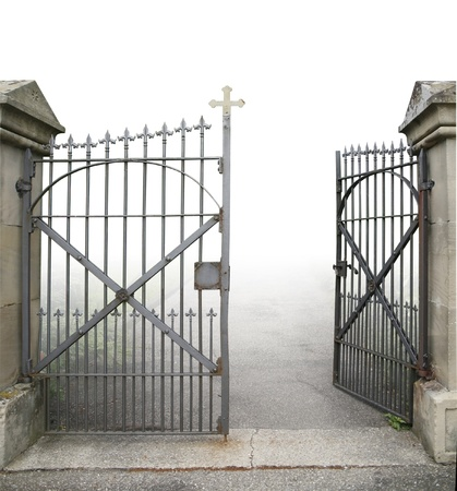 entrance of a graveyard with a open wrought-iron gate in gradient