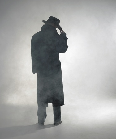 woman with dark coat standing in the fog Stock Photo - 10840297