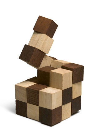 studio photography of a wooden 3D-puzzle in white back photo