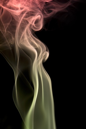 abstract picture showing some colorful smoke in black back