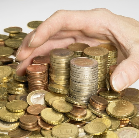 hand while gathering euro coins photo