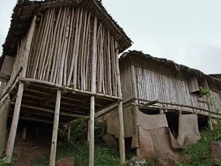 low angle shot of traditional wooden houses in Uganda (Africa) photo