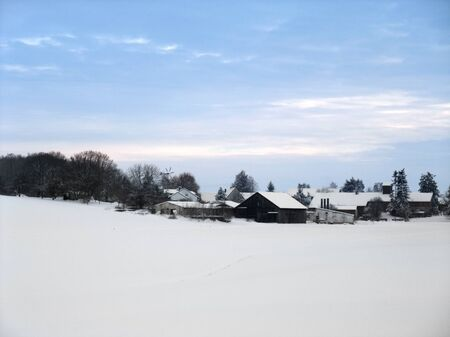 idyllic rural winter scenery with small village at evening time in Hohenlohe, an area in Southern Germany Stock Photo - 10838945