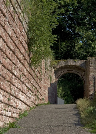 wertheim: old wall and archway near Wertheim Castle in Germany at summer time