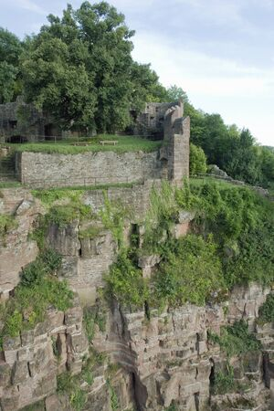 wertheim: scenery around Wertheim Castle in Southern Germany with rock formation and walls at summer time
