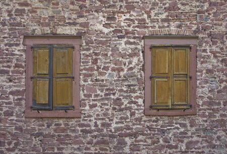 wertheim: frontal shot of a stone wall including old windows (In the Wertheim Castle in Southern Germany)
