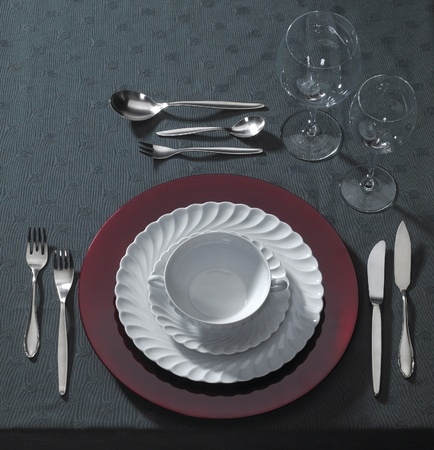 classy place setting on dark table cloth seen from above photo