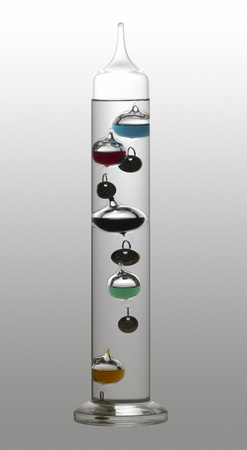 temperature theme showing a Galileo thermometer in gradient back, with clipping path photo