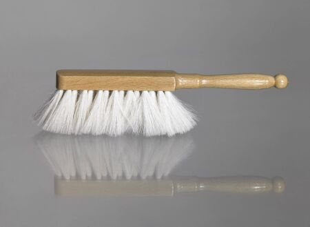besom: a small besom on reflective glass surface