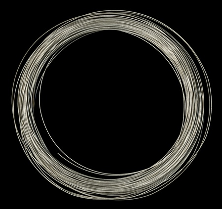 studio photography of rolled silver wire in black back Stock Photo - 10839507