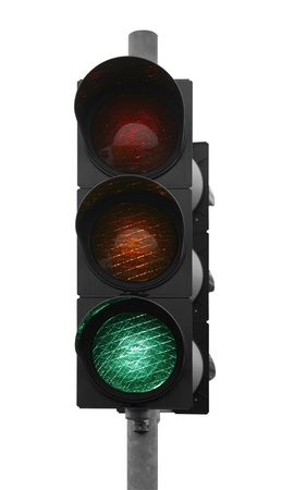 green traffic control signal isolated on white photo