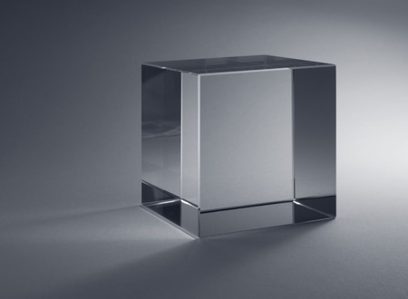 studio photography of a solid glass cube in grey back photo