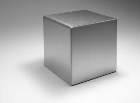 solid silver: studio photography of a solid metal cube in light back