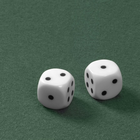 gambling theme with two dice on green felt Stock Photo - 10839683