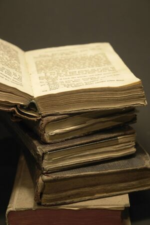 detail studio photography showing a stack of historic books photo