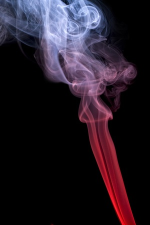 morphing: abstract picture showing some multicolored smoke in black back