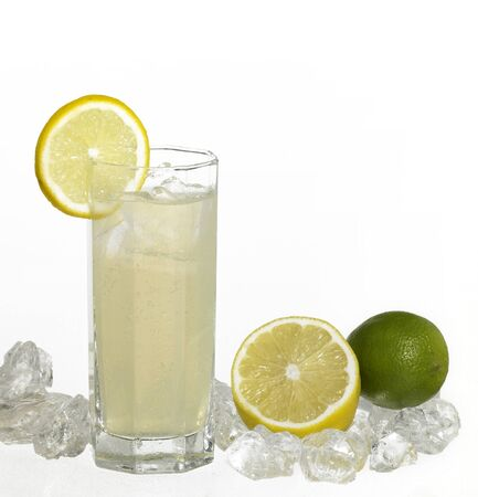 commercialization: translucent soft drink drink in light back with lemon fruits and ice cubes