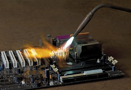 main board: dashing flame from a welding rorch while burning a main board wich is located in rusty ambiance