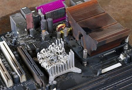 meltdown: main board detail with molten heat sink Stock Photo