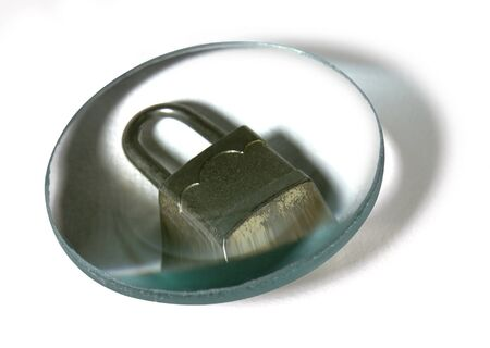 security theme with closed padlock under a glass lens in white back with clipping path