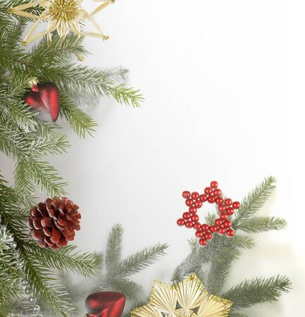 scenery set: christmas decoration frame with various baubles and fir branch in light back  Stock Photo