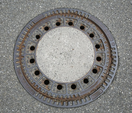 holey: round manhole cover seen from above
