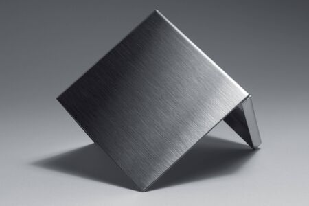 allegory painting: studio photography of a angled metal piece in grey back