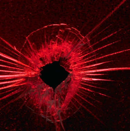 full penetration in structured glass on red back Stock Photo - 10839688