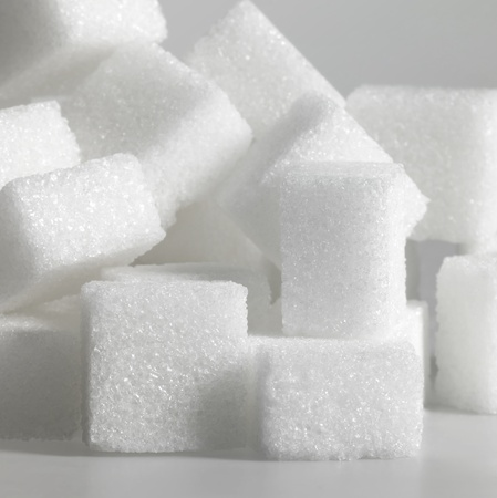 allegory painting: closeup studio photography of lump sugar in light grey back