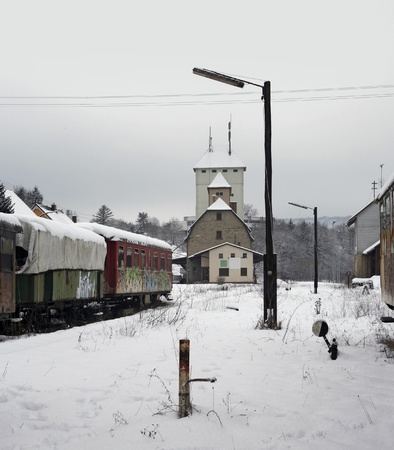 discarded: outdoor shot of old railway cars and station in Southern Germany at winter time