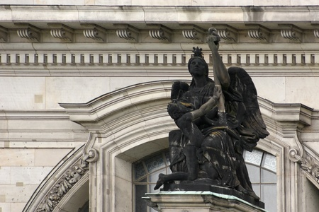 detail of the Cathedral in Berlin (Germany) showing a black figure in front of the white decorative house facade Stock Photo - 10839873